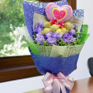 12 Purple Roses & 6 Rocher With Heart-Shape Pillow Hand Bouquet
