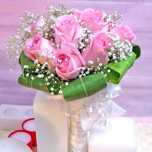 12 Pink roses wrapping with cordyline foliage