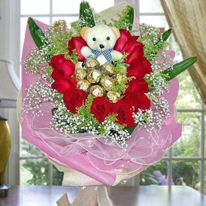 11 Red Roses with 9 Ferrero Roche and Bear Hand Bouquet