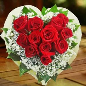 12 Red Roses Hand Bouquet Arranged in Heart Shape.