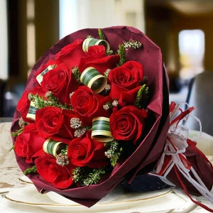 12 Red Roses With Dark Red Paper Wrapper Hand Bouquet