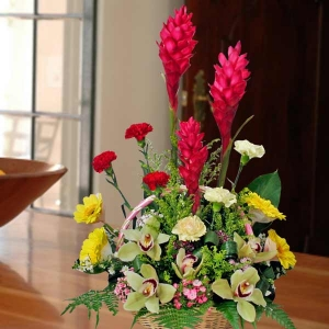 Symbidium orchids with Red Ginger flower table arrangement