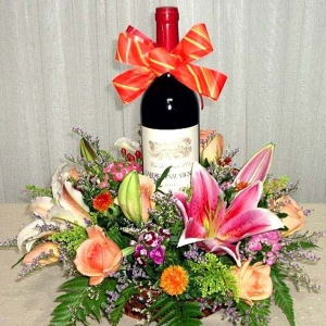 Red wine with Pink lily and champagne roses