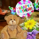 18cm Bear and a Happy Birthday Balloon with Yellow Gerbera Standing Bouquet.