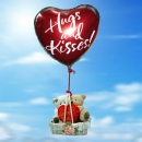 A Pair Of Love Bears in a basket with 18 Inch Helium Filled Heart (HUGS & KISSES!) Mylar Floating Balloon