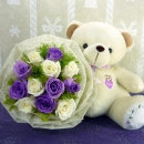 Sitting 12 Inches Bear with 6 White and 6 Purple Roses...