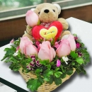 6 Peach Roses Arrangement, An Adorable Bear Sitting On Top.