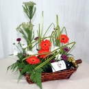 Red Wine with Orange Gerbera Arrangement.