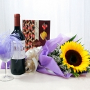 Sunflower with red wine and assorted chocolate.