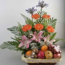 Pink lilies & Orange Gerbera Flowers With Fruits Basket Arrangement