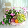 Pink Carnation And Fruits Basket Arrangement