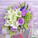 6 Lily & 6 Purple Roses Handbouquet.