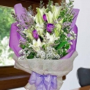 9 lily with 3 purple roses Handbouquet