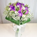 12 Purple Roses, White Phoenix Wrap With Dracaena Foliage