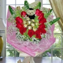 11 Red Roses with 9 Ferrero Roche and  Graduation Bear Hand Bouquet