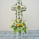 Yellow Gerbera and White Pompom in cross metal stand.