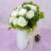 12 White Roses with Purple Pheonix and cordyline foliage...